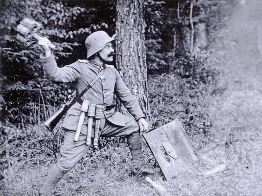 WWI German stormtroop officer demonstrating the use of cluster grenades against tanks and bunkers, 1914-18