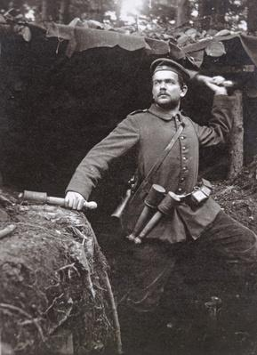 WWI German grenadier armed with stick grenades, 1915