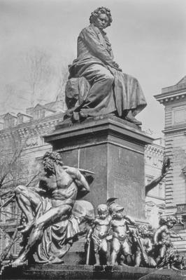 Monument to Ludwig van Beethoven, the composer seated on a pedestal above figures alluding to the Ninth Symphony, by Kaspar Ritter von Zumbusch