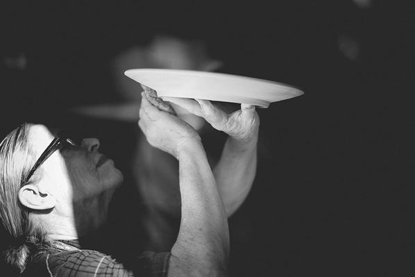 Potter Sandy Simon Examines a Plate   Global Oneness Project