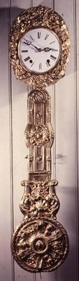 Comptoise clock with pressed brass surround to the dial, and detail of pendulum, 19th century