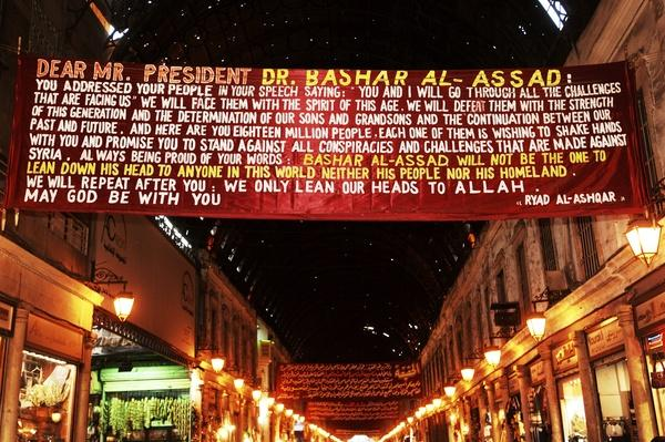Banner supports Syrian President Bashar al-Assad | Conflicts: Syria