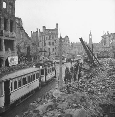 Streetcars running through ruins of bldg | World War II