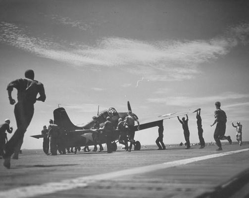 Flight deck crew running to assist plane | World War II