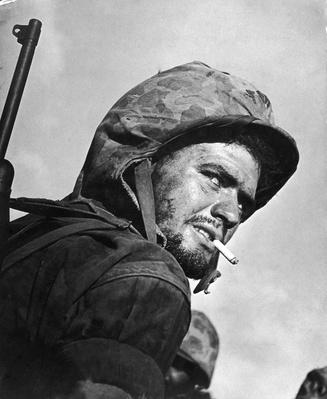 Grizzled & weary US soldier smoking a cigarette du | World War II