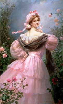 Elegant woman in a rose garden