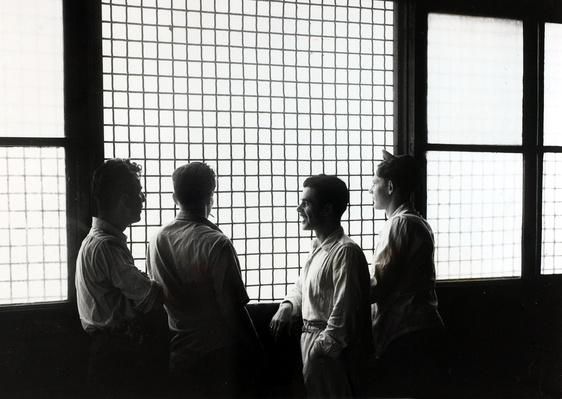 Detainees Look out from the Windows of Ellis Island, New York | U.S. Immigration | 1840's to present | U.S. History