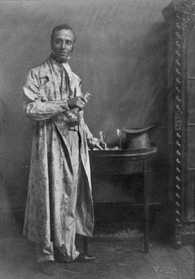 Photograph of a grey morning coat of flowered chintz with nankeen trousers