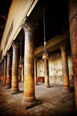 Ancient lanterns hanging between columns | World Religions: Christianity