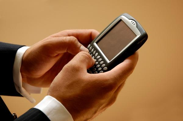 Mobile Businessman Sending A Text Message | The Evolution of the Mobile Phone