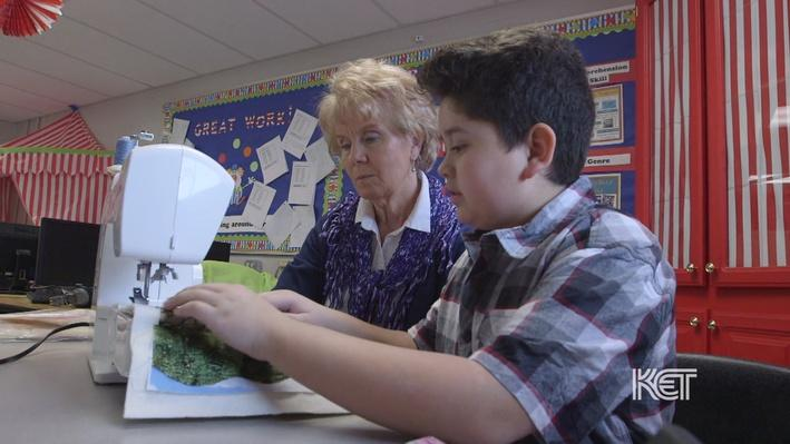 A quilter helping an elementary student sew a quilt block on a sewing machine.