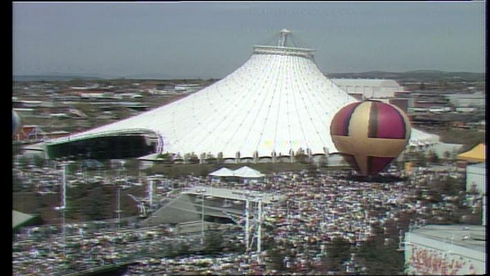 Color photograph of the U.S. Pavilion tent, crowds, and hot air baloon at Expo 74 in Spokane, WA
