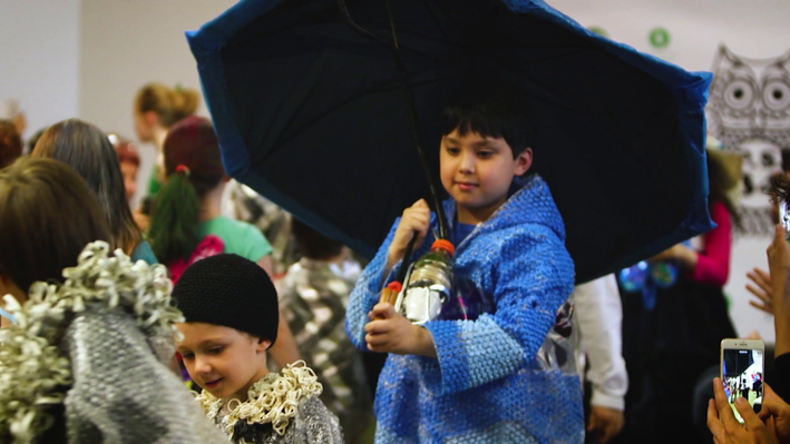 Kids walking the runway at an ecofashion show