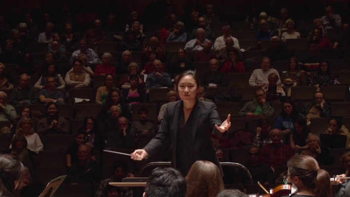 Woman conducting an orchestra