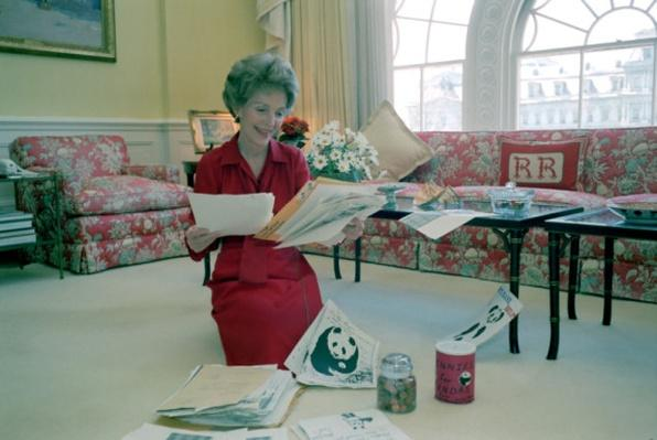 First Lady Nancy Reagan Reading Mail for Pennies for Pandas