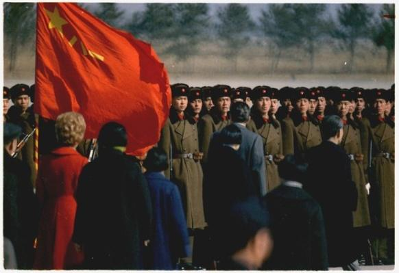 President and Mrs. Nixon's arrival in Peking, China. Nixon reviewing troops at the airport