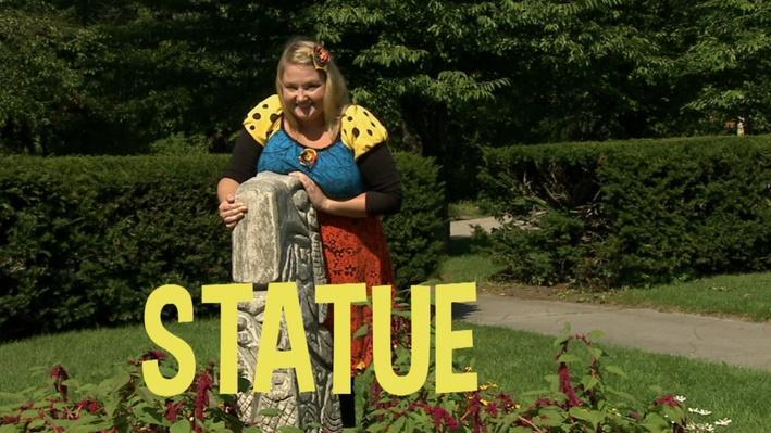 Statue | Lecture de mots au parc