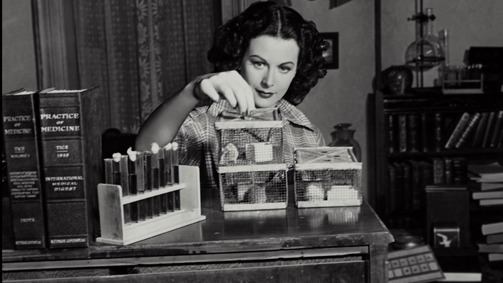 Hedy Lamarr working at her invention table.