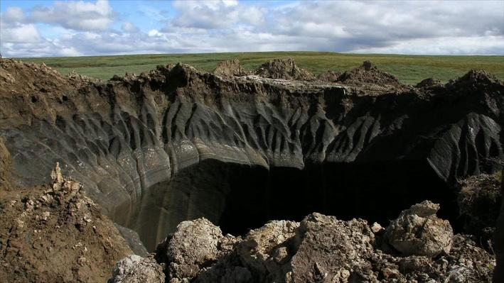 Sinkholes in Siberia Raise and Climate Change | PBS Newshour