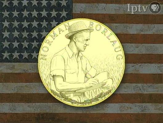 image of gold coin with Norman Borlaug's face in it, US flag in the background