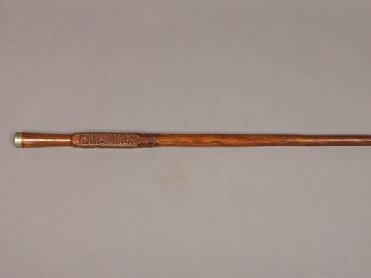 a long thin wooden cane made by a Confederate soldier while imprisoned