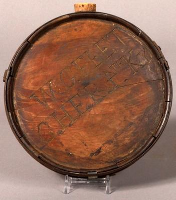 "round wooden canteen madeof cedar with ""W. C. FLETCHER 4TH KY"" carved into the side"