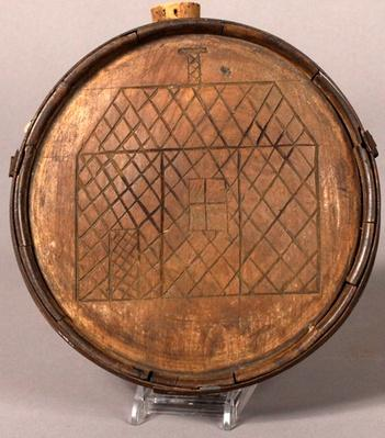 round wooden canteen made of cedar with a house carved into the side