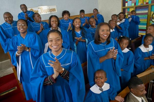 Portrait of a Gospel Choir Clapping Their Hands in a Gospel Service | World Religions: Christianity