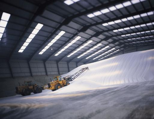 Bulldozer Piling Mounds of Sugar in Warehouse | Earth's Resources