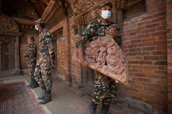 A Nepali Soldier Carries an Intricately Carved Decoration | Global Oneness Project
