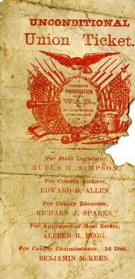 a yellowed handbill with red text that shows american flags, an eagle, a drum, a cannon and more that is advertising the Unconditional Union Party