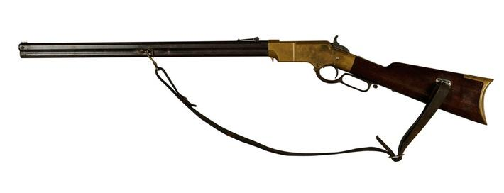 long wooden Civil War era rifle with bronze details and a leather strap