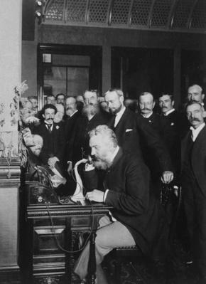 Alexander Graham Bell opening a long distance phone line from New York to Chicago in 1892.