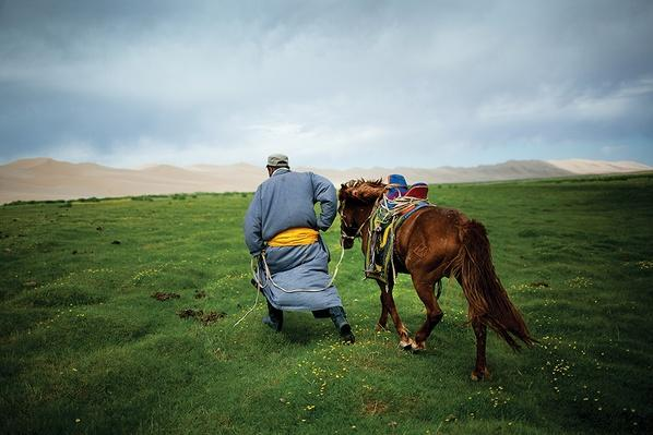 A Herder Leads His Horse to a Watering Hole | Global Oneness Project
