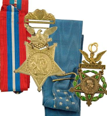 two medals -- one with a grold star with red, white, and blue striped ribbon; and one with a cold stary and blue ribbon with stars.