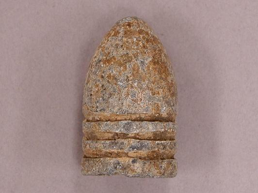 a weathered looking lead bullet