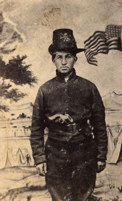 Union soldier posed with painted camp backdrop