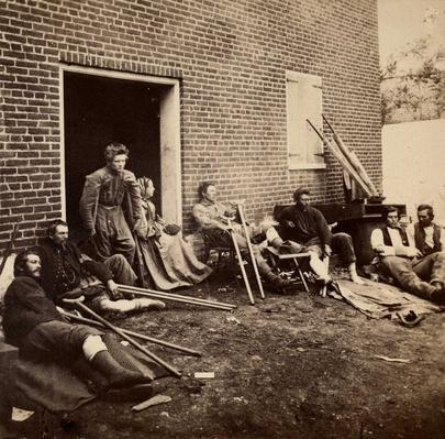 Sanitary Commission nurse and her patients at Fredericksburg, Va. (May 1864)