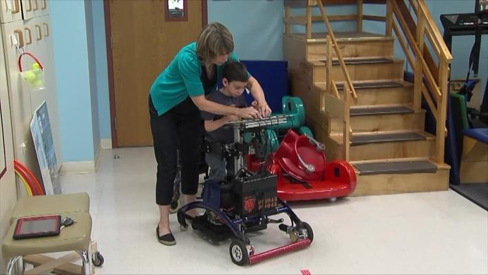 Boy Using Pediatric Stander