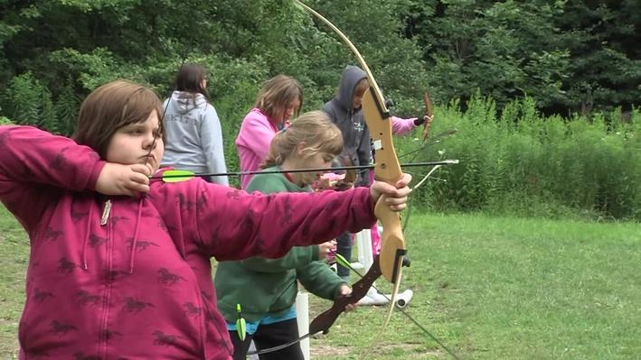 Kids at Camp Eagr participating in archery