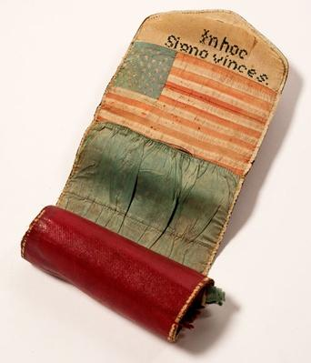 a small red sewing kit decorated with a U.S. flag