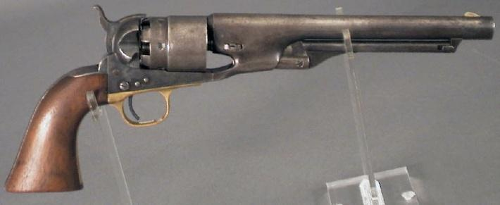 photo of a small army gun with a wooden handle