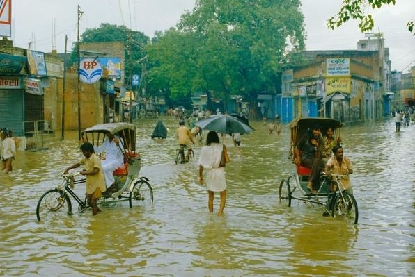 Rickshaws Being Pushed Through the Monsoon Floods in a Town | Earth's Surface