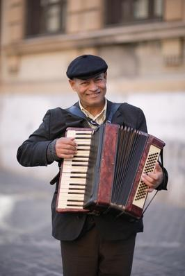 Italy, Rome, portrait of accordion player smiling | Musical Instruments