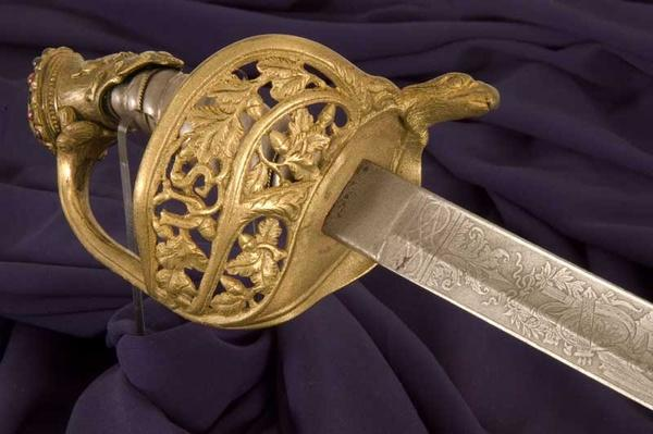 tight shot of ornate gold details on hilt of sword
