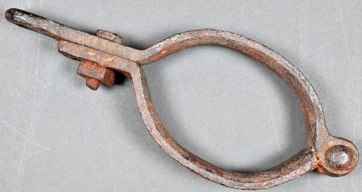 iron restraint used on the hands and feet of prisoners