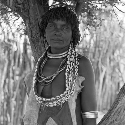 Hamar mother wearing traditional leathers and bead adornment | Global Oneness Project