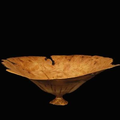 A turned wood footed red maple vessel by Jack Fifield, 1983