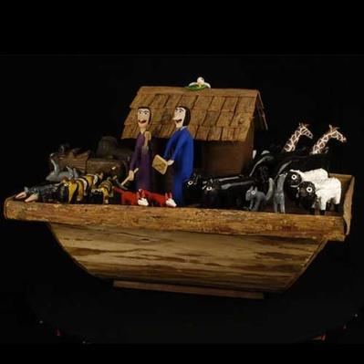 A painted wood carving of noah's ark by Minnie Adkins and Garland Adkins, 1992
