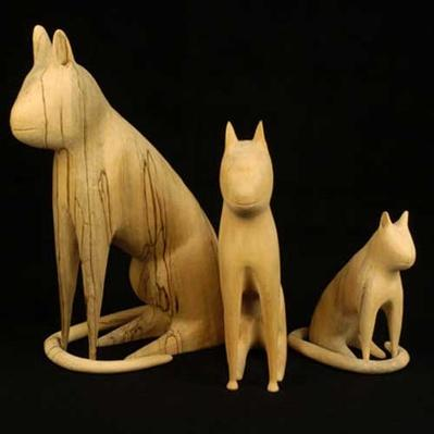 Three wood cats by Linvel Barker, 1989 and 1993